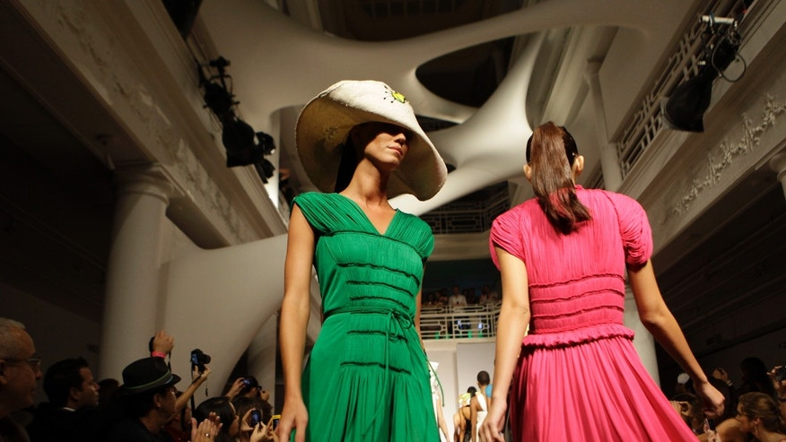 Models walk down the runway during Isabel Toledo's spring and summer collection show, Wednesday, Oct. 19, 2011, in Miami. (AP Photo/Lynne Sladky)