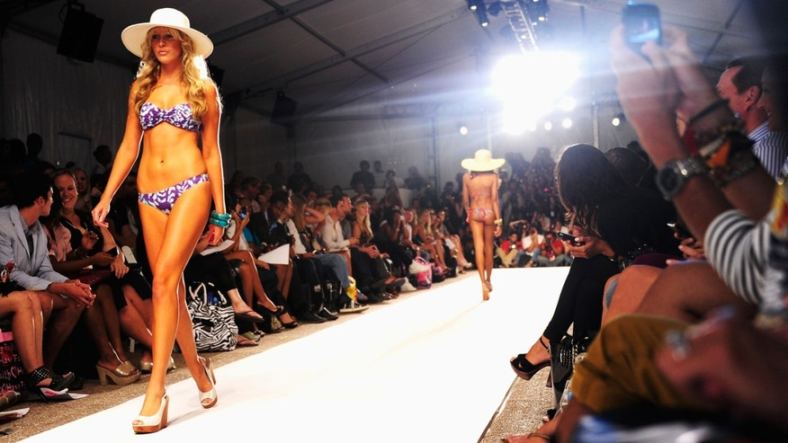MIAMI BEACH, FL - JULY 18: Models on the runway during the Zingara Swimwear MBFW Swim 2012 show at The Raleigh on July 18, 2011 in Miami Beach, Florida.  (Photo by Andrew H. Walker/Getty Images for Mercedes-Benz Fashion Week)
