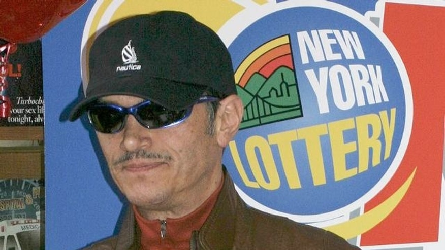 Juan Rodriguez, 49, sole winner of a $149 million lottery, left, and his wife Iris attend a news conference in New York, Sunday, Nov. 21, 2004. The winnings from Friday night's, Nov. 19, 2004, drawing are said to be the biggest single jackpot payout in New York state lottery history (AP Photo/John Marshall Mantel)