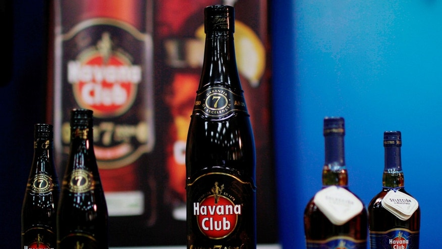 Bottles of Havana Club rum sit on display during a video conference between the Havana Club rum company in Havana and their associates in Paris at Pernod Ricard in Havana, Cuba, Tuesday, June 5, 2012.  Time and again U.S. courts have ruled against Cuba in its fight to control the U.S. rights to the trademark Havana Club, the island's flagship rum brand which is sold in more than 120 countries around the world, but not in the United States.  By mid-June, Cuba could lose all chance of pressing its legal claims against Bacardi, which distributes a limited quantity of its own Havana Club rum in Florida and says it plans to expand to other states in the near future.  (AP Photo/Franklin Reyes)