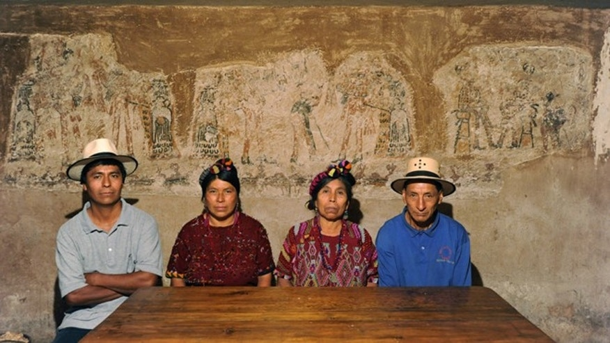 Five years ago Lucas Asicona Ramírez (far right, pictured with family) began scraping his walls while renovating his home in the Guatemalan village of Chajul. As the plaster fell away, a multi-wall Maya mural saw light for the first time in centuries.