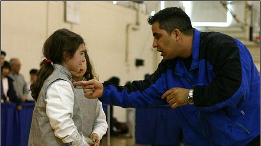 Coach Morales coaching a fencing student in 2003.