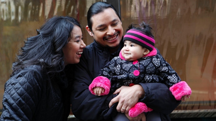 Mary Jane Montoya, shown here with her proud parents Sara and Billy Montoya, of Fresno, California had the winning photo in the 2012 Gerber Generation Photo Search, announced on the Today Show, November 6, 2012 in New York City. (Amy Sussman /AP Images for Gerber)