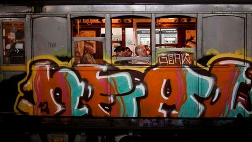 "Passengers travel in a wooden carriage car on the historic subway system, Line A, in Buenos Aires, Argentina, Wednesday, Jan. 2, 2013. The city government announced that the almost 100-year-old 'La Brugeoise""wooden carriages will be replaced in a short time by modern Chinese units. (AP Photo/Natacha Pisarenko)"