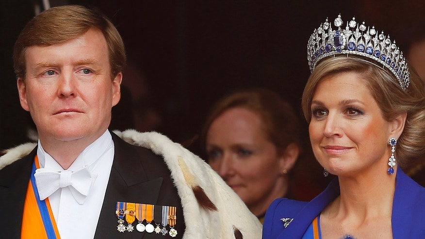 Dutch King Willem-Alexander and his wife Queen Maxima leave the Nieuwe Kerk or New Church in Amsterdam, The Netherlands, after his inauguration Tuesday April 30, 2013. Around a million people are expected to descend on the Dutch capital for a huge street party to celebrate the first new Dutch monarch in 33 years. (AP Photo/Daniel Ochoa de Olza)