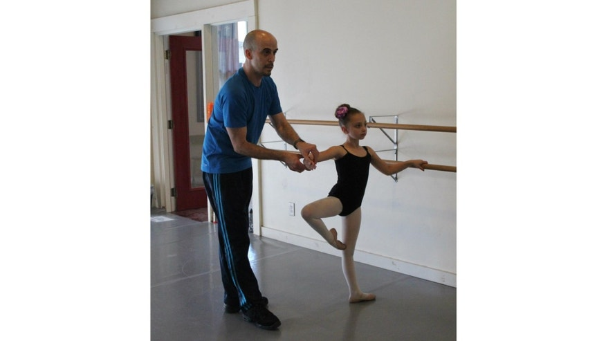 Ernesto Quenedit teaching a student at his Quenedit Ballet School in San Antonio. Photo credit: Tracy Parnella Gardner.