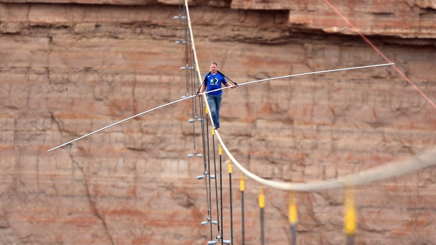 IMAGE DISTRIBUTED FOR DISCOVERY COMMUNICATIONS - Nik Wallenda walks across a 2-inch wire 1500 feet above the ground to cross the Grand Canyon for Skywire Live With Nik Wallenda on the Discovery Channel, Sunday, June 23, 2013 at the Grand Canyon, Calif. (Tiffany Brown/AP Images for Discovery Communications)