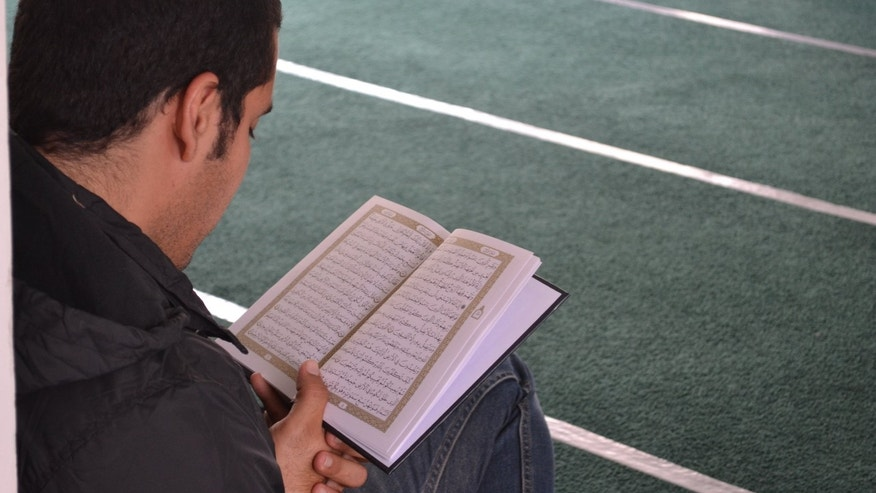 Mexican convert reading from the Quran.