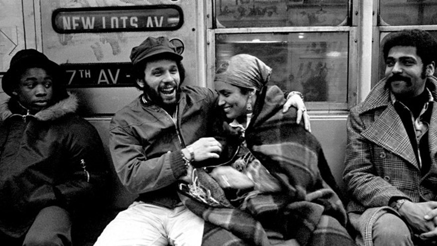 An iconic image of Nuyorican poets Miguel Piñero and Sandra María Esteves riding the New York City subway in the 1970s.