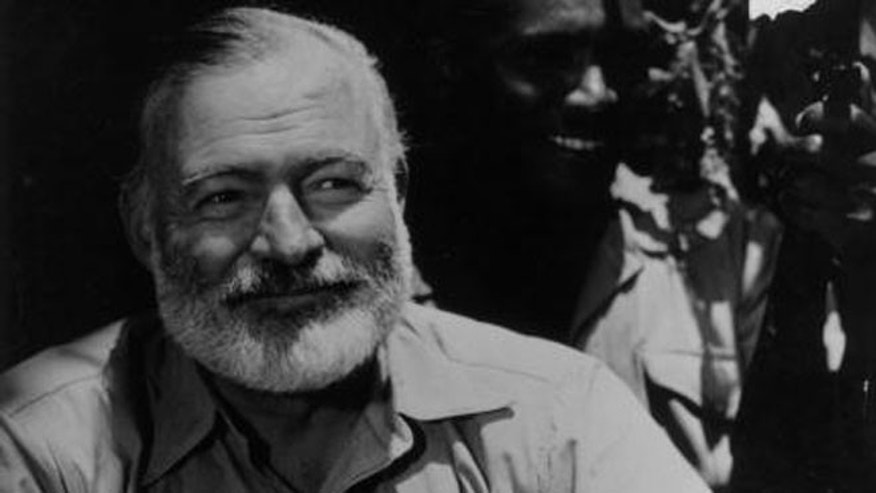 1954:  American novelist Ernest Hemingway (1899 - 1961) on safari in Africa.  (Photo by Picture Post/Hulton Archive/Getty Images)