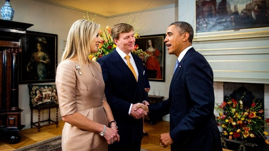 THE HAGUE, NETHERLANDS - MARCH 24:  King Willem-Alexander of The Netherlands and Queen Maxima of The Netherlands greet U.S. President Barack Obama at the Royal Palace Huis ten Bosch on March 24, 2014 in The Hague, Netherlands. The Nuclear Security Summit, held March 24-25, will be attended by world leaders and is aimed at preventing nuclear terrorism.  (Photo by Koen Van Weel - Pool/Getty Images)