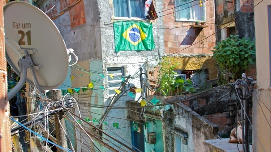 Two ubiquitous sights in the Vidigal favela are the Brazilian flag and satellite dishes. (Photo: Andrew O'Reilly/Fox News Latino)