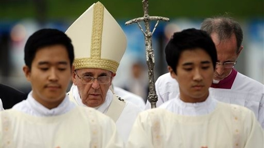 Pope Francis walks with the pastoral staff as he celebrates a mass concluding the 6th Asian Youth Day in Haemi, South Korea, Sunday, Aug. 17, 2014. (AP Photo/Gregorio Borgia)