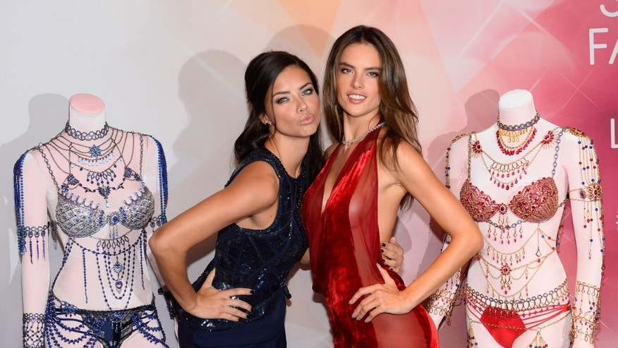 LAS VEGAS, NV - NOVEMBER 13:  Models Adriana Lima (L) and Alessandra Ambrosio attend the Victoria's Secret Dream Angels Fantasy Bra debut at the Fashion Show mall on November 13, 2014 in Las Vegas, Nevada.  (Photo by Bryan Steffy/Getty Images for Victoria's Secret)