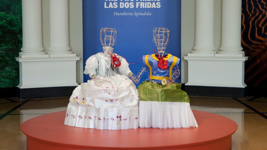 "This 2015 photo provided by The New York Botanical Garden shows ""The Two Fridas"" by artist Humberto Spindola on display at the ""Frida Kahlo: Art, Garden, Life"" exhibit at The New York Botanical Garden in Bronx, N.Y. The show runs May 16 through Nov. 1, 2015.  (Ivo M. Vermeulen/The New York Botanical Garden via AP)"
