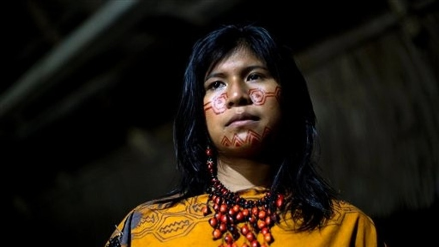 In this June 23, 2015 photo, Yeni Casiano Barboza, 15, from the Ashaninka Indian community, Natividad, poses for a photo while waiting to compete in the annual beauty contest, in the Otari Nativo village, Pichari, Peru. For Ashaninka men, a woman's beauty is determined in part by her hair, her sense of humor, and whether she can cook a tasty cassava dish, according to some community members. (AP Photo/Rodrigo Abd)