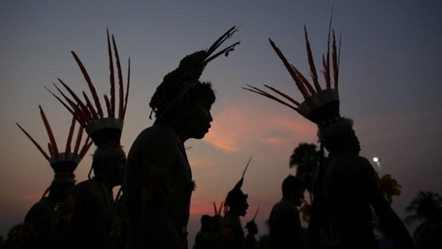 Kuikuro Indians dance during the ceremony of the sacred fire of the World Indigenous Games, in Palmas, Brazil, Thursday, Oct. 22, 2015. Billed as the indigenous Olympics, the games are expected to attract nearly 2,000 athletes from dozens of Brazilian ethnicities, as well as from such far-flung nations as Ethiopia and New Zealand. (AP Photo/Eraldo Peres)