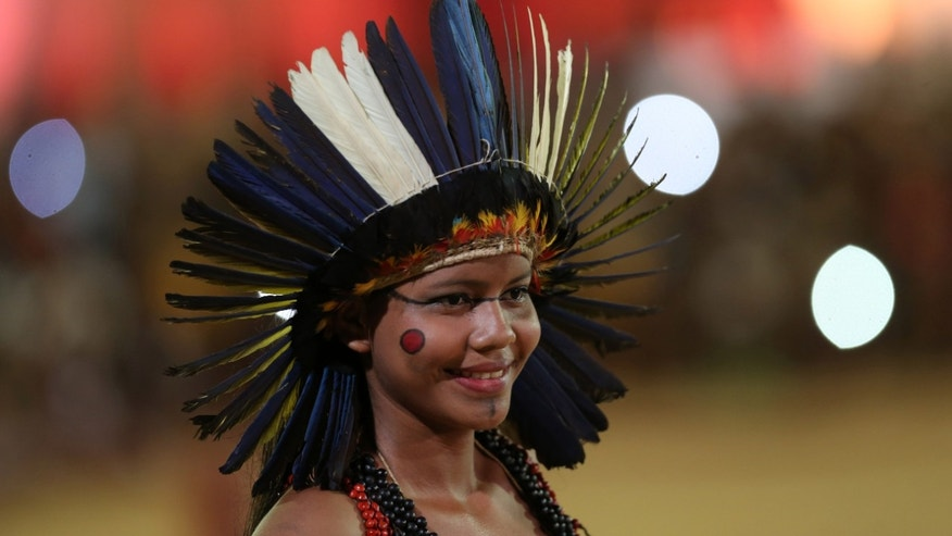 "In this picture taken Saturday Oct. 24, 2015,  Adelma Simoes Madeira, 16,  a Brazilian Terena, smiles during parade of indigenous beauty at World Indigenous Games, in Palmas, Brazil, Saturday, Oct. 24, 2015. A 16-year-old from the Terena people of central Brazil, with wide-set eyes and an even wider smile, Madeira was one of more than 60 women and girls taking part in the ""parade of indigenous beauty,"" at the World Indigenous Games in Brazil. (AP Photo/Eraldo Peres)"