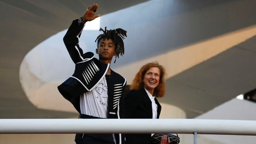 Jaden Smith waves to fans from a ramp of the Contemporary Art Museum where he was attending the Louis Vuitton Cruise 2017 collection fashion show, in Niteroi, Brazil, Saturday, May 28, 2016. The elite of the fashion world flocked to Brazil, defying an outbreak of the Zika virus, an economic meltdown and the profound political crisis afflicting the country to attend a runway show Saturday by revered French label. (AP Photo/Leo Correa)