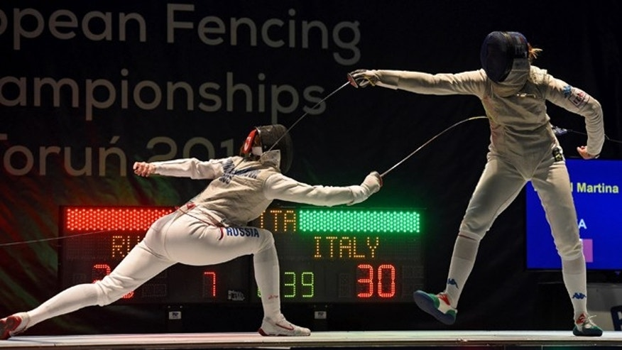 TORUN, POLAND - JUNE 24: In this handout image provided by FIE, Martina Batini of Italy competes against Larisa Korobeynikova of Russia during the final of women's foil team European Fencing Championships on June 24, 2016 in Torun, Poland. (Photo by Augusto Bizzi/FIE via Getty Images).