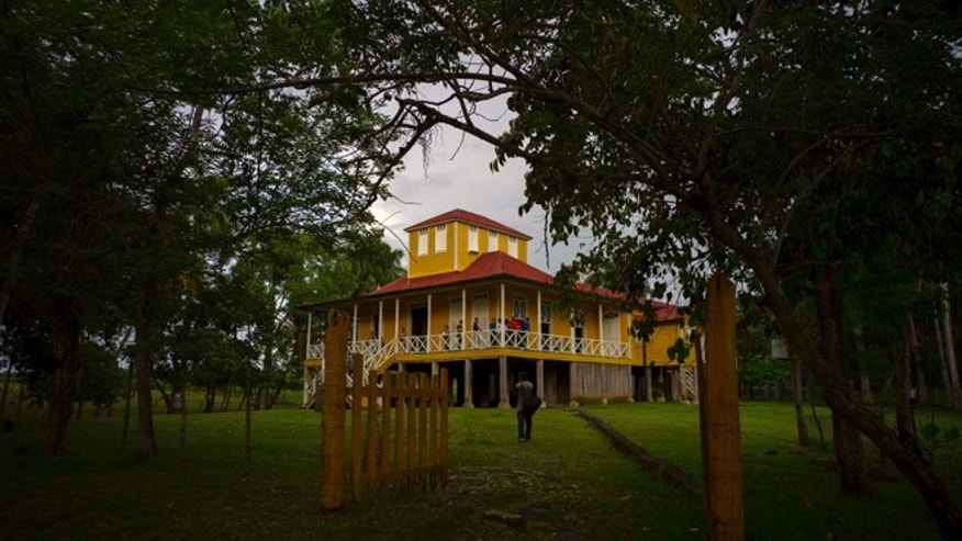 This June 10, 2016 photo shows the home-turned-museum where Fidel and Raul Castro grew up in Biran, Cuba. Their father Angel planted and sold sugarcane and timber as well as raised cattle here, deep in the lush green hill country of Holguin province in eastern Cuba. (AP Photo/Ramon Espinosa)