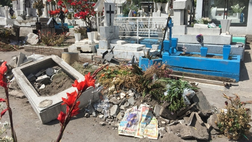 Broken tombs left by graverobbers at the Iztapalapa cemetery in Mexico City. People in Mexico are skipping traditional Day of the Dead celebrations at graveyards because of criminal activity. (Photo: Alasdair Baverstock/Fox News Latino)
