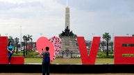 "People take pictures of a ""LOVE"" display day before Valentine's Day in Rizal park, metro Manila, Philippines February 13, 2017. REUTERS/Romeo Ranoco - RTSYDN7"
