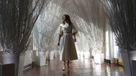 "First lady Melania Trump walks along the East Colonnade decorated in white branches that are part of 2017 holiday decorations with the theme ""Time-Honored Traditions"" at the White House in Washington, Monday, Nov. 27, 2017.  (AP Photo/Carolyn Kaster)"