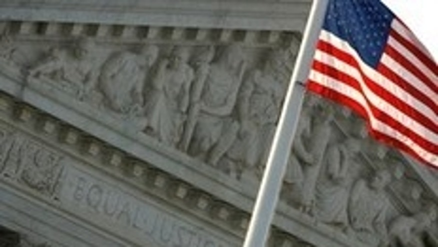 WASHINGTON - AUGUST 07:  The U.S. flag flies in front of the West Pediment of the Supreme Court building on August 7, 2009 in Washington, DC. Judge Sonia Sotomayor will be sworn in as the 111th justice of the Supreme Court on Saturday.  (Photo by Chip Somodevilla/Getty Images)
