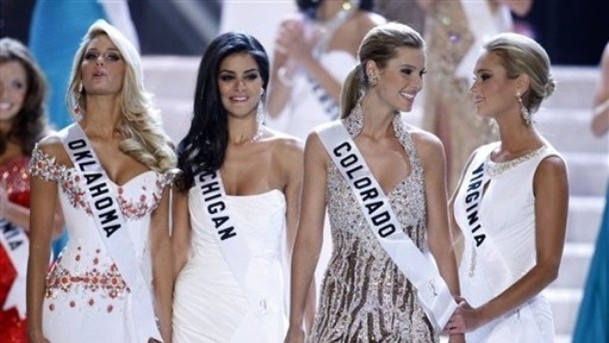 Finalists Morgan Elizabeth Woolard, left, Miss Michigan Rima Fakih, Miss Colorado Jessica Hartman and Miss Virginia Samantha Evelyn Casey react as Hartman is named third runner-up during the Miss USA 2010 pageant Sunday, May 16, 2010 in Las Vegas. Fakih was later crowned Miss USA. (AP Photo/Isaac Brekken)