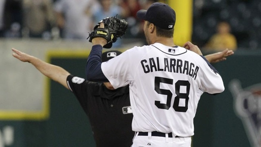 June 2: Detroit Tigers pitcher Armando Galarraga (58) looks at first base umpire Jim Joyce (partially obscured) who called Cleveland Indians' Jason Donald safe in the ninth inning of a baseball game.