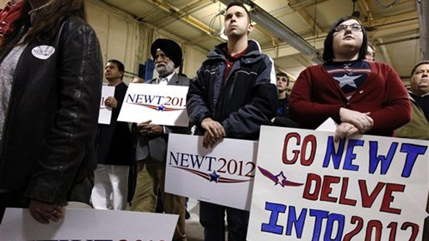 Jan. 2, 2012: Supporters watch as Newt Gingrich speaks at his campaign headquarters in Davenport, Iowa.