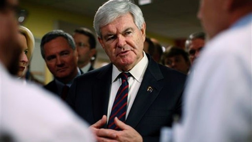 Jan. 20, 2012: Newt Gingrich listens to staff during visit to Children's Hospital in Charleston, S.C.