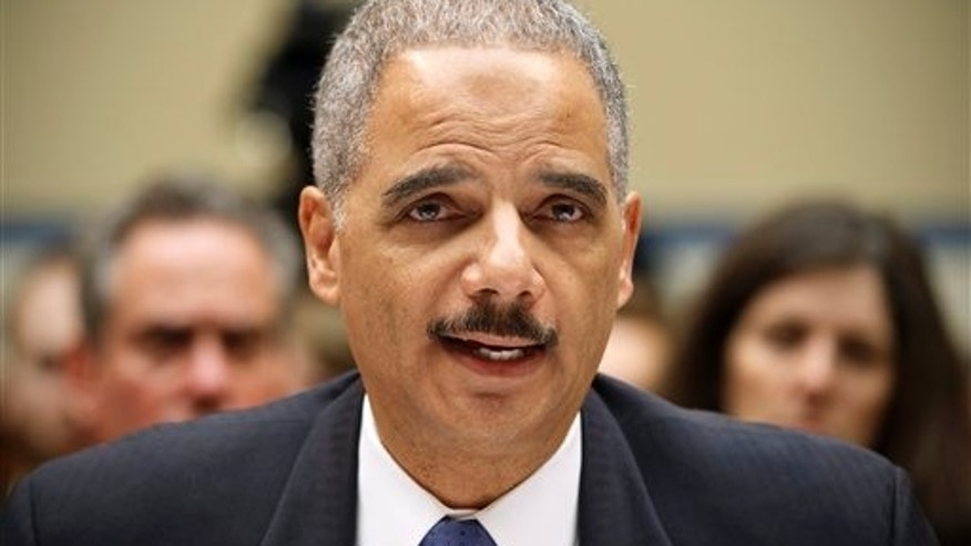 "Feb. 2, 2012: Attorney General Eric Holder testifies on Capitol Hill in Washington before the House Oversight and Government Reform Committee hearing on ""Operation Fast and Furious."""