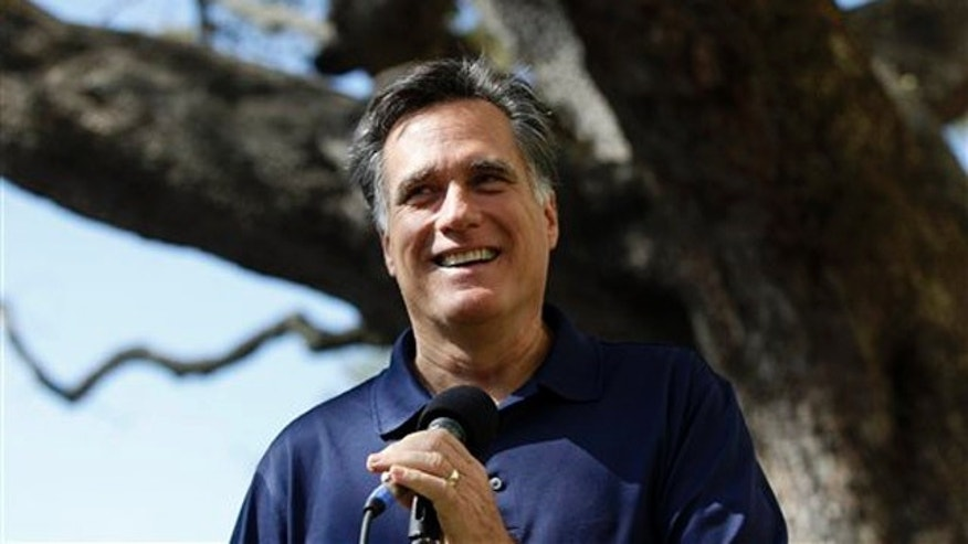 Jan. 31, 2012: Mitt Romney takes questions from reporters at his campaign office in Tampa, Fla.