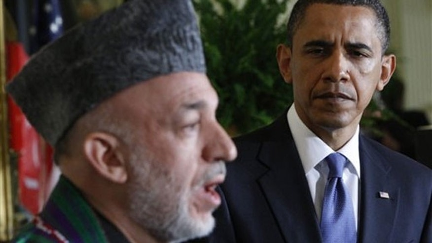 File: President Barack Obama, right, and Afghanistan's President Hamid Karzai, during a joint May 12 news conference in the East Room of the White House in Washington.