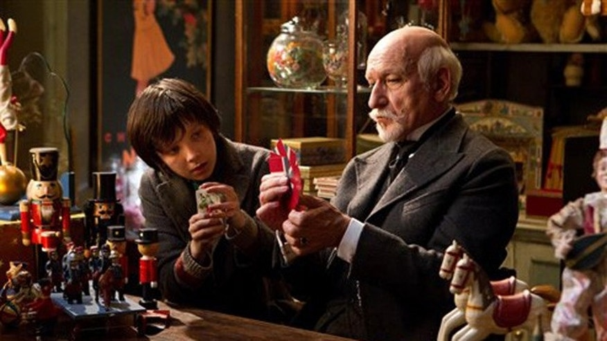 "Asa Butterfield portrays Hugo Cabret, left, and Ben Kingsley portrays Georges Melies in a scene from the Oscar-nominated ""Hugo."""