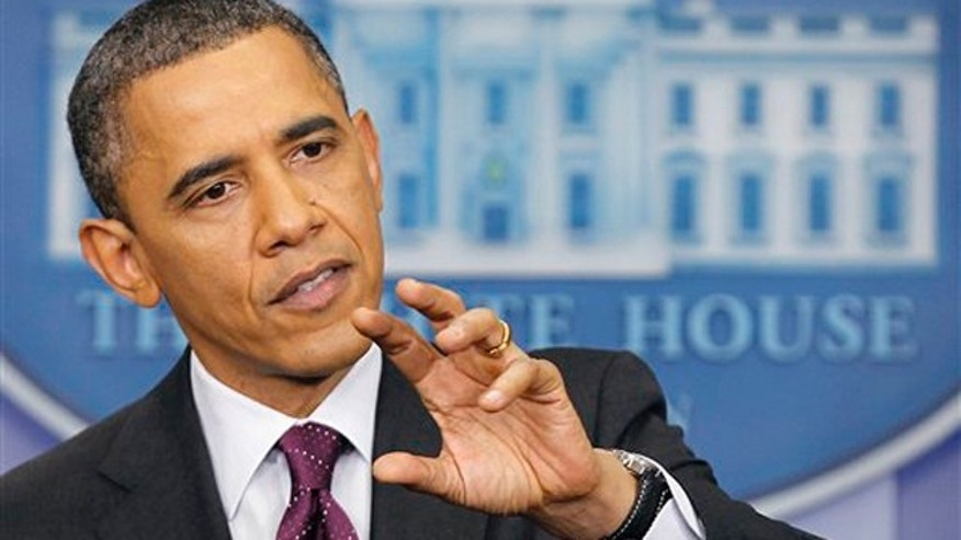March 6, 2012: President Obama gestures during a news conference in the James Brady Press Briefing Room of the White House.