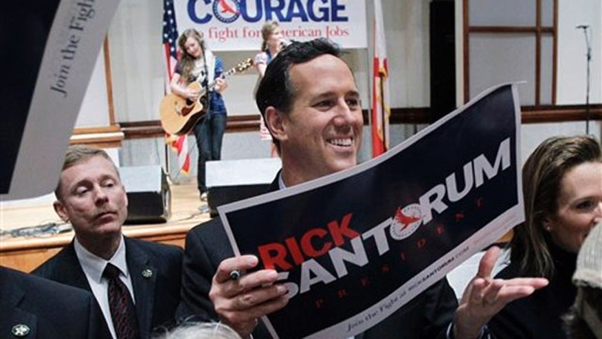 March 12, 2012: Rick Santorum visits with supporters during a rally in Montgomery, Ala.