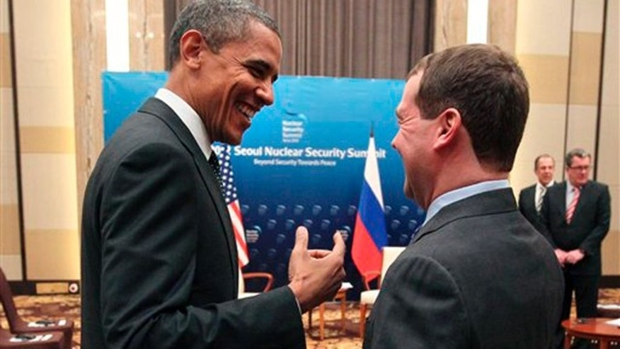 President Obama and Russian President Dmitry Medvedev talk following the conclusion of their bilateral meeting at the Nuclear Security Summit in Seoul, South Korea.