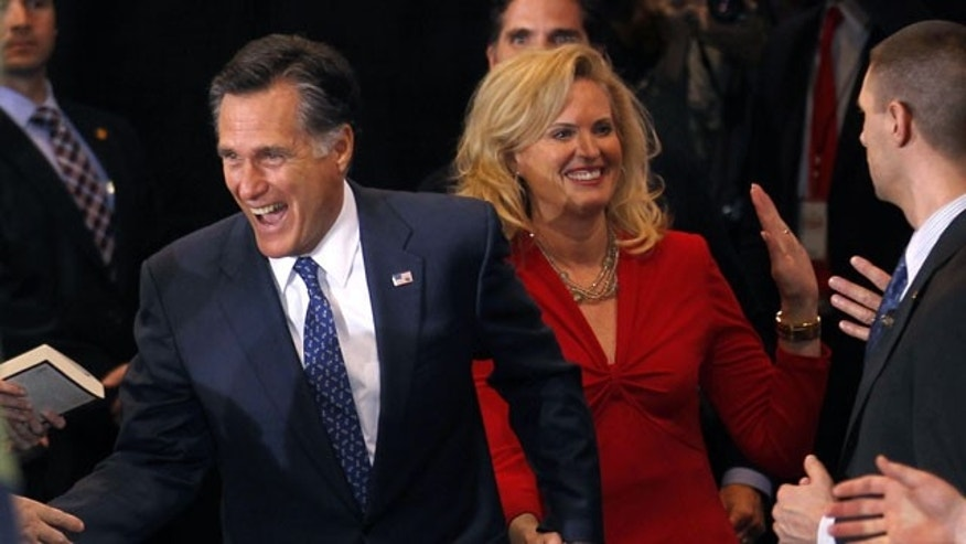 Feb. 28, 2012: Republican presidential candidate, former Massachusetts Gov. Mitt Romney, arrives with his wife Ann at his election watch party after winning the Michigan primary in Novi, Michigan.