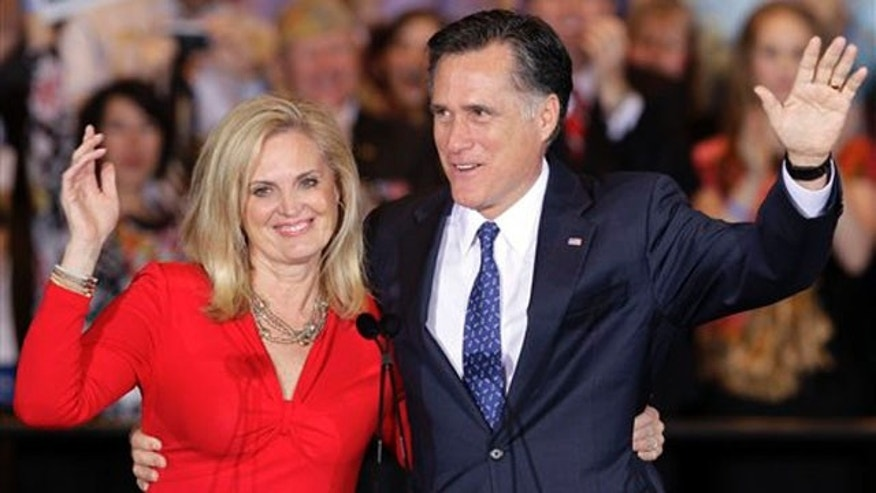 March 20, 2012: Republican presidential candidate, former Massachusetts Gov. Mitt Romney and his wife Ann wave as they leave at an election night rally in Schaumburg, Ill., after winning the Illinois Primary.
