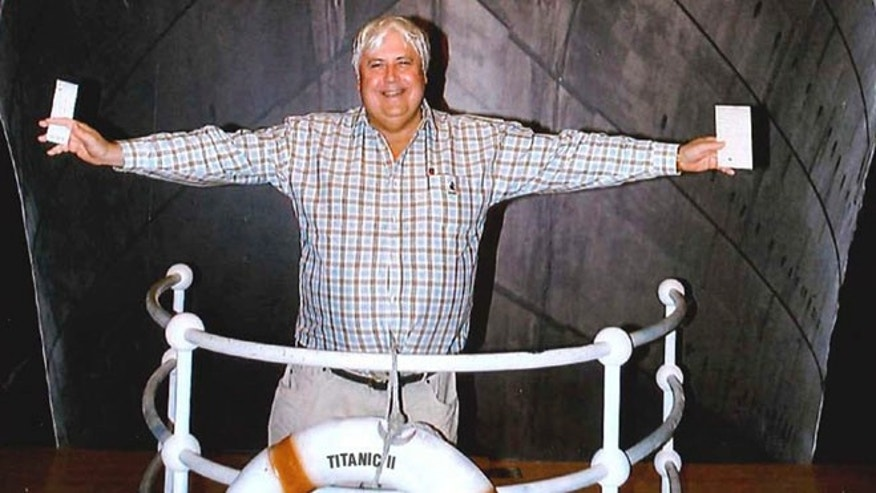 In this April 25, 2012 photo provided by Crook Publicity, Australian billionaire Clive Palmer poses in front of an artist impression of the Titanic ll at MGM Studios in Los Angeles, Ca. Palmer said Monday, April 30, 2012, that he'll build a high-tech replica of the Titanic at a Chinese shipyard and its maiden voyage in late 2016 will be from England to New York, just like its namesake planned.