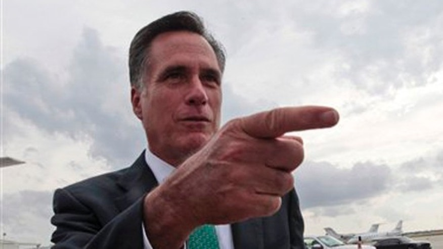 Republican presidential candidate, former Massachusetts Gov. Mitt Romney, gestures while speaking to reporters on the tarmac after arriving in West Palm Beach, Fla., Thursday, May 17, 2012.  (AP Photo/Mary Altaffer)
