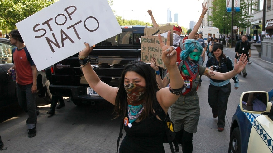 May 18, 2012: Protesters block traffic on Michigan Ave., as they march through the city during a demonstration, ahead of this weekends' NATO summit in Chicago.