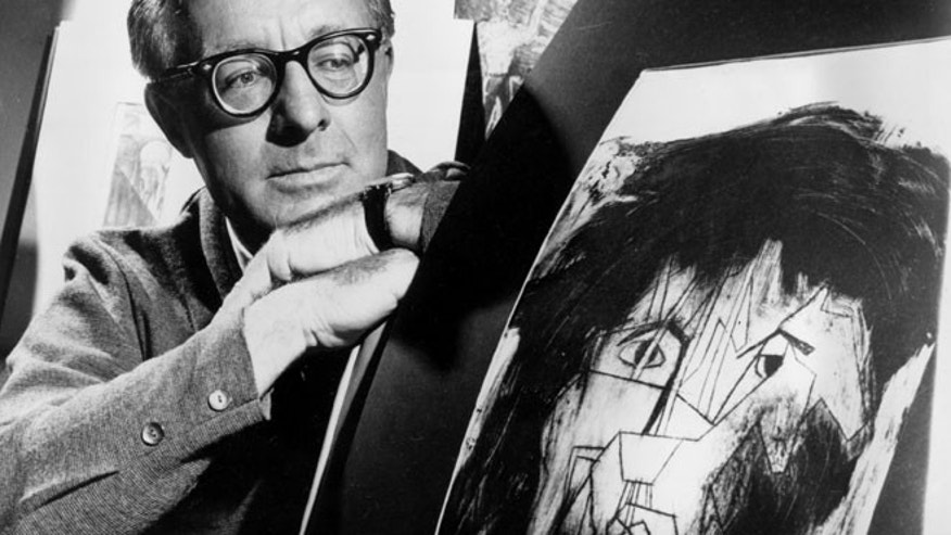 FILE - This Dec. 8, 1966 file photo shows science fiction writer Ray Bradbury looks at a picture that was part of a school project to illustrate characters in one of his dramas in Los Angeles. Bradbury, who wrote everything from science-fiction and mystery to humor, died Tuesday, June 5, 2012 in Southern California. He was 91.