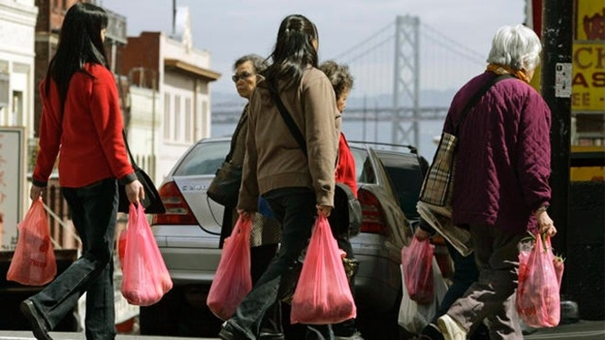 FILE: Women shoppers walk with plastic bags in the Chinatown district of San Francisco.