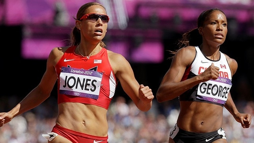 Aug. 6: United States' Lolo Jones, left, and Canada's Phylicia George compete in a women's 100-meter hurdles heat during the athletics in the Olympic Stadium at the 2012 Summer Olympics in London. (AP)