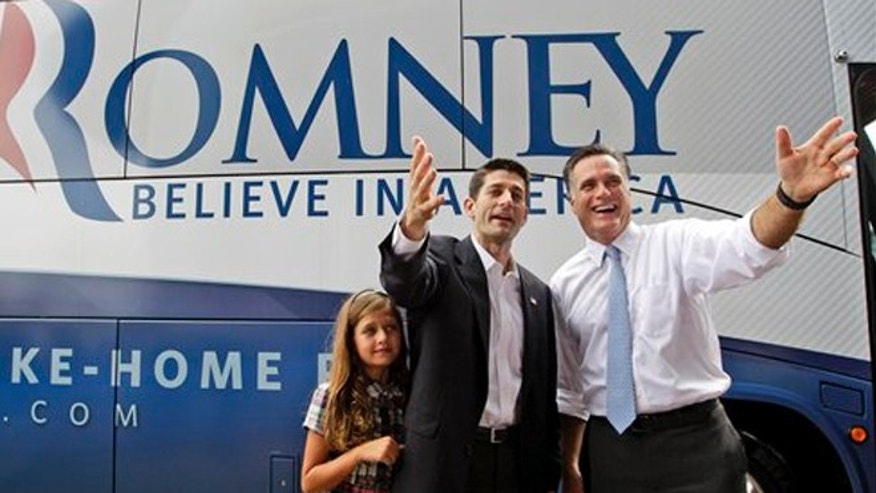 Mitt Romney, right, and vice presidential candidate Wisconsin Rep. Paul Ryan are joined by Ryan's daughter Liza in Norfolk, Va.