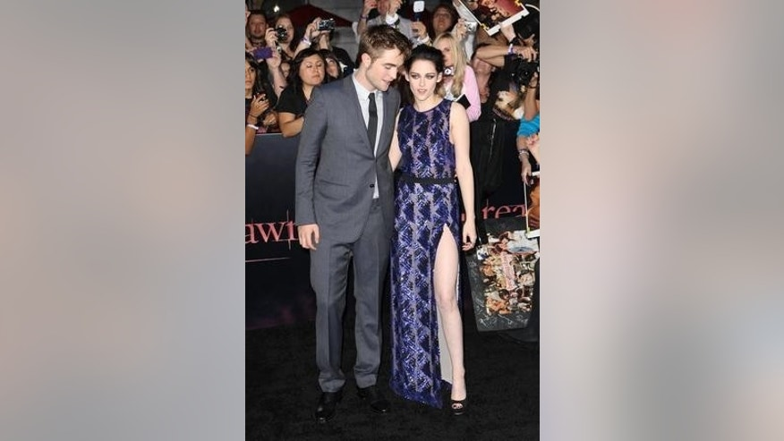 Robert Pattinson and Kristen Stewart arrive at the premiere of Summit Entertainment's 'The Twilight Saga: Breaking Dawn - Part 1' at Nokia Theatre L.A. Live on November 14, 2011 in Los Angeles, California.X17online.com